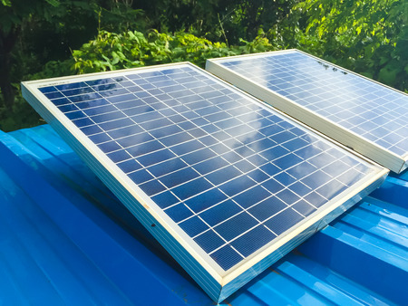 Solar panels are used to generate electricity in the home. Stock Photo