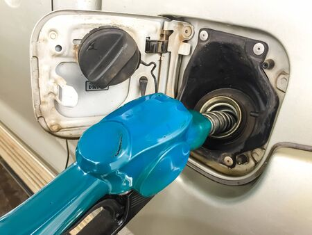 Fuel pump nozzle in the fuel tank of a car, refuel Stock Photo