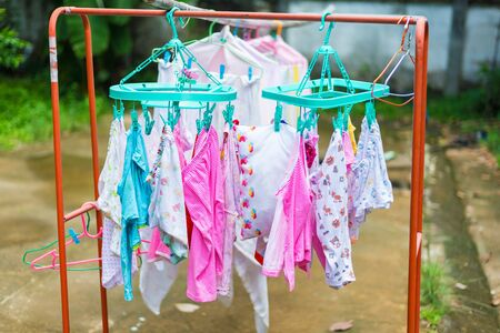 Diaper hanging on a clothes line.