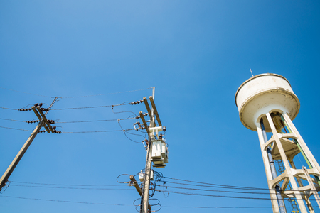 Electricity post and a blue sky background.