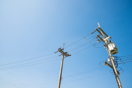 isolator: Electricity post and a blue sky background.