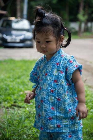 Asian girl wearing a Japanese dress, jinbei Stock Photo
