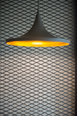 Recessed ceiling lights in a coffee shop,Recessed ceiling lights on a steel grating background.