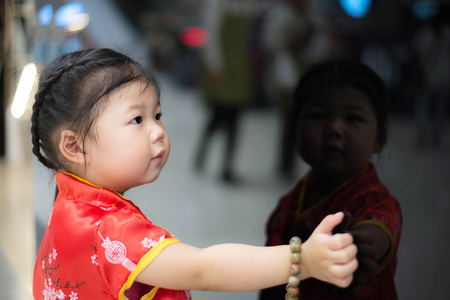 Girl in red Chinese dress. Фото со стока