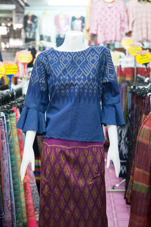 Thai traditional cloth, Thai fasion, Thai traditional clothing set on puppets in Thai clothing stores.