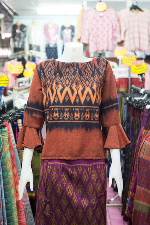 Thai traditional cloth, Thai fasion, Thai traditional clothing set on puppets in Thai clothing stores. Banco de Imagens - 122207538
