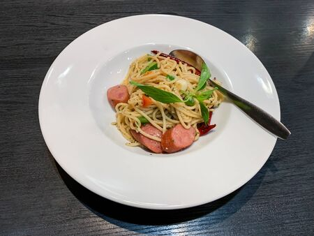Delicious spaghetti Sausage in restaurant of Thailand Banco de Imagens - 131996838