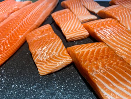 Raw salmon fish fillet on black background Banco de Imagens