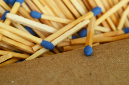 wooden matches on a box, social distance example wit matches