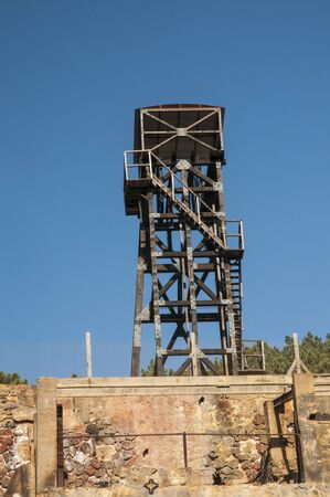 Mineral extraction tower abandoned old iron mine natural light Reklamní fotografie