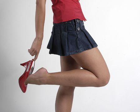MODEL WITH RED SHOES AND miniskirt photo