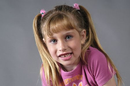 between 5 and 10 years: BLONDE GIRL WITH BLUE EYES Stock Photo