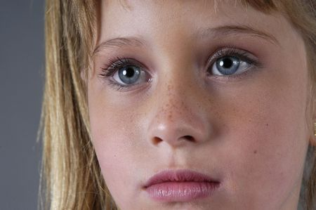 10 years girls: BLONDE GIRL WITH BLUE EYES Stock Photo