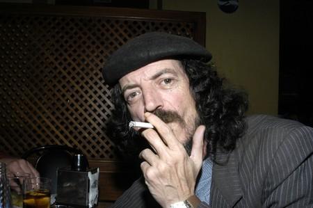 beardless: Man with a beret smoking
