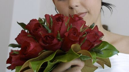 Bride with bouquet of red roses Stock Photo - 4094328