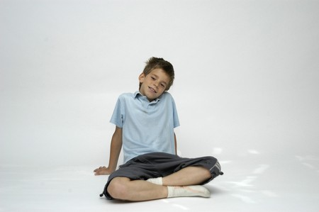 between 5 and 10 years: boy with short-sleeved shirt seated