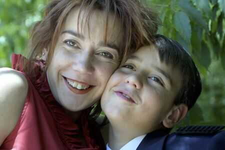 between 30 and 40 years: Mother hugging her son Stock Photo