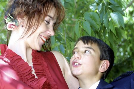 between 5 and 10 years: Mother hugging her son Stock Photo