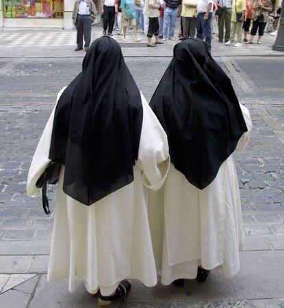 catholic nuns: Religious nuns walking down the street Stock Photo