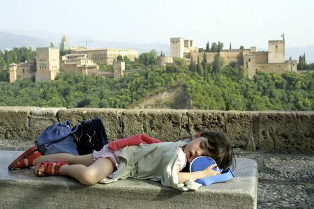 Girl sleeping in front of the Alhambra in Granada photo