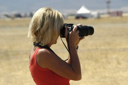 between 30 and 40 years: Female photographer taking pictures
