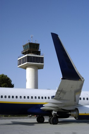 control tower: Granada airport with planes and the background the control tower