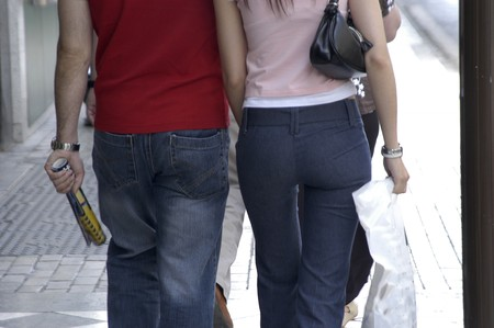 informal clothing: Pair of young lovers