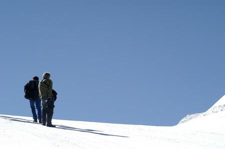 bergbeklimmen: Bergbeklimmen in de hoge bergen Stockfoto
