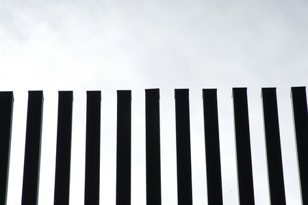 parallelism: DETAILS OF ARCHITECTURE WITH IRON BARS  Stock Photo