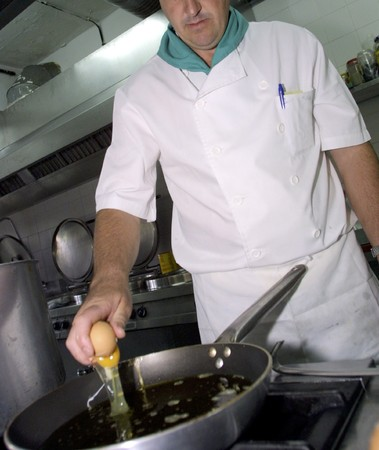 Cook an egg frying Stock Photo - 4048930