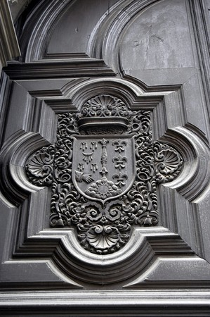 marcos: Carved wooden RECORDED IN THE SIDE DOOR OF THE CHURCH OF THE STREET OUT OF GRANADA  Stock Photo