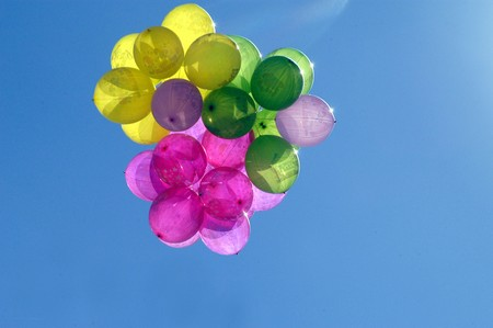 Colored balloons next to hospital photo