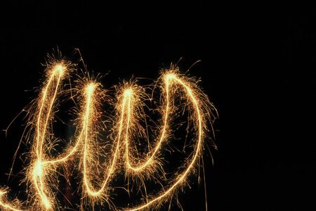 END written word in the air with a flare, in Spanish photo