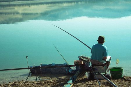 인내: Fisherman fishing rod 스톡 사진