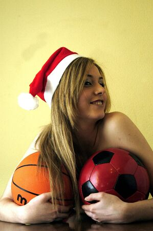 18 to 30s: Beautiful young woman with Christmas hat and balloons