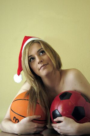 Beautiful young woman with Christmas hat and balloons photo