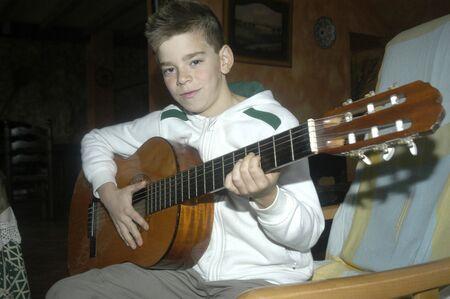 Boy playing guitar photo