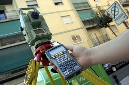 developers: Surveyor driving a theodolite