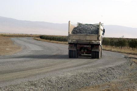 dump truck: Sandy road