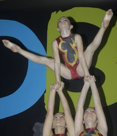 Gymnasts making a display of acrobatic gymnastics at the Gala of Andalusia based sport, with the Minister of Sports and Tourism of Andalusia, in the Palacio de Congresos de Granada 10/12/2009 Stock Photo - 6896531
