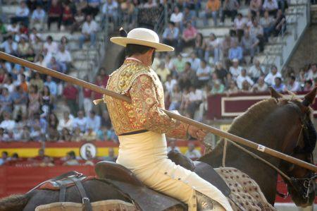 matadors: picador and his horse in the bullring in granada (spain) in the bull corpus fair june 2007