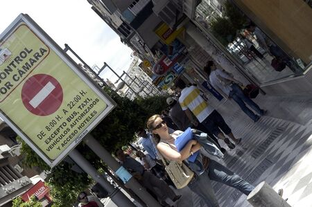 rebates: summer sales in the shopping streets of granada, with many people in the mall called open. summer 2007
