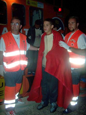 immigrants: 20070822- Motril - Granada - Spain - Patera of illegal immigrants on their arrival at the port of Motril, accompanied by Red Cross and Civil Guard