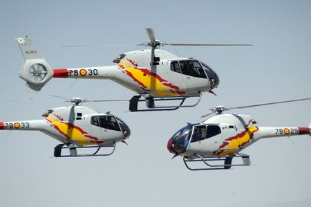 helicopters in an air show photo