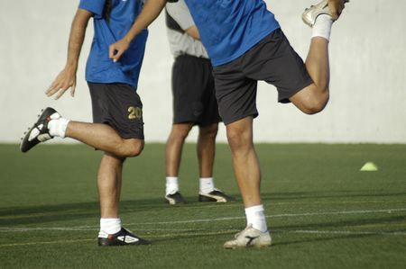 football party: Footballer doing physical exercise