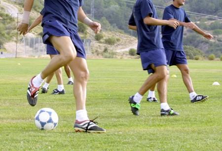 Footballer doing physical exercise photo