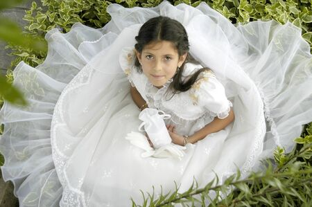 Girl with first communion dress photo