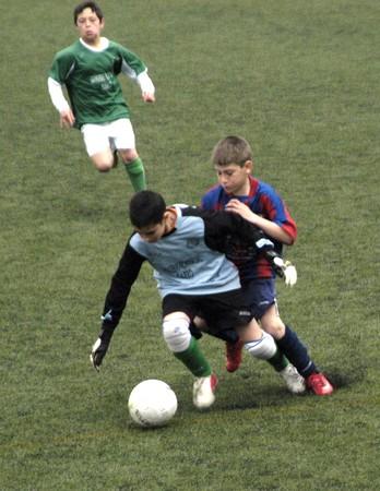 2009/03/28- Granada-Spain-Football game between the Vandalia Alevín A against Atletico Darro, where the Vandalia was proclaimed league champion just four days. Stock Photo - 7603096