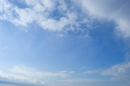 white fund: background of clouds against a blue sky