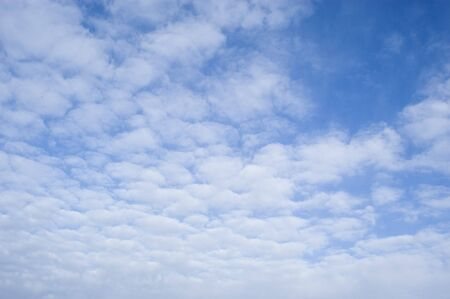 climatology: background of clouds against a blue sky